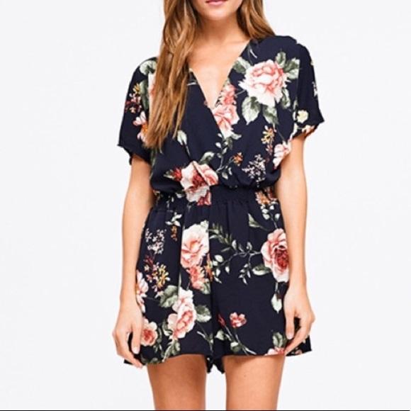Dresses & Skirts - Host Pick ⭐️ 8.24.19 Navy blue floral romper